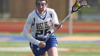 West Islip's Riley Hill carries the ball upfield