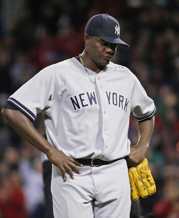 Michael Pineda walks off the mound after being