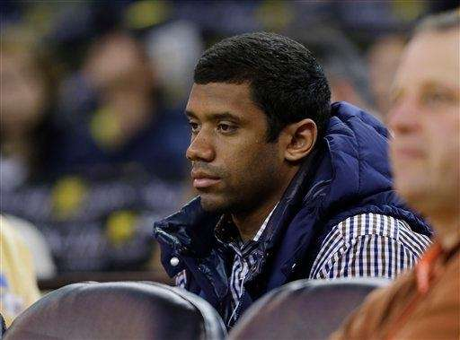 Seattle Seahawks quarterback Russell Wilson looks up at