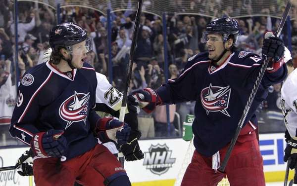 Columbus Blue Jackets' Ryan Johansen, left, celebrates his