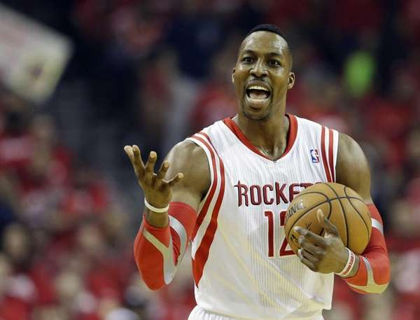 Houston Rockets' Dwight Howard reacts during the first