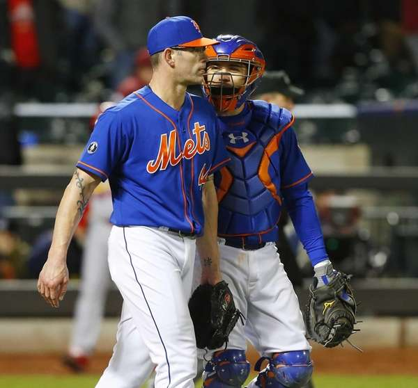 Travis d'Arnaud and Kyle Farnsworth of the Mets
