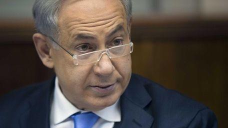 Israeli Prime Minister Benjamin Netanyahu heads the weekly