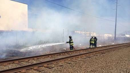 Members of the East Farmingdale fire department extinguish