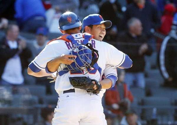 Daisuke Matsuzaka and Anthony Recker of the Mets