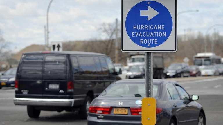 The Hurricane Evacuation route sign at the intersection