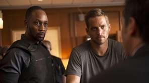 "RZA, left, and Paul Walker in ""Brick Mansions."""