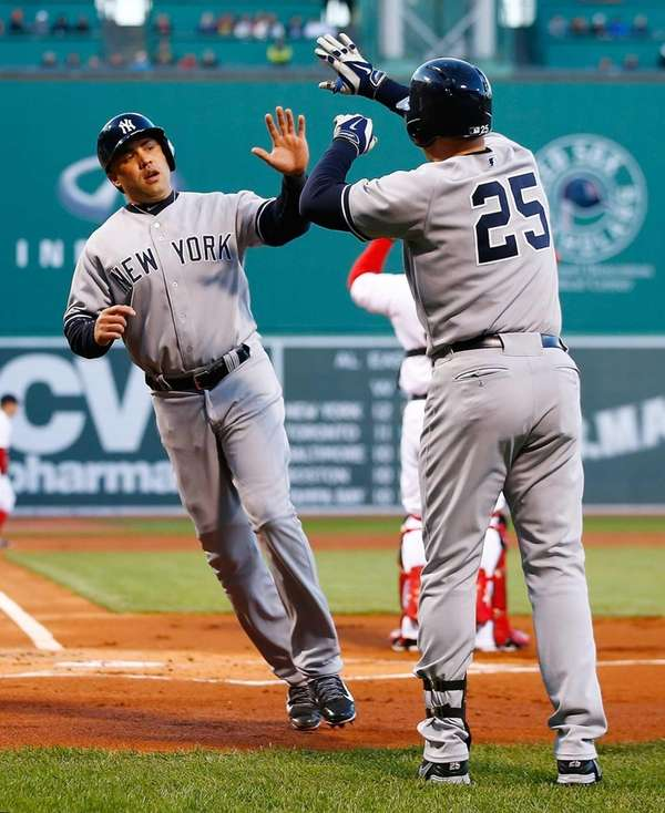 Carlos Beltran of the Yankees is congratulated by