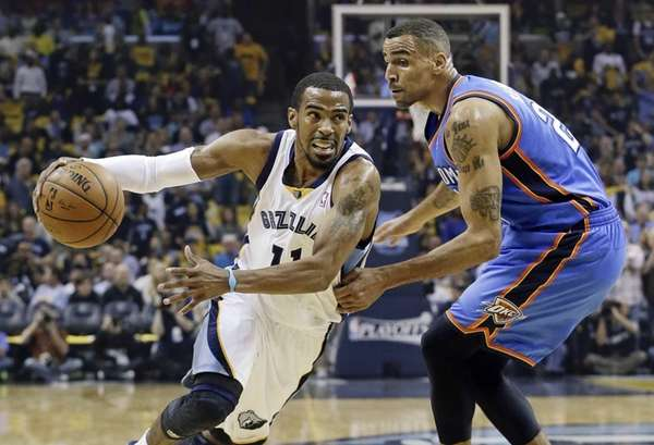 Memphis Grizzlies guard Mike Conley drives against Oklahoma