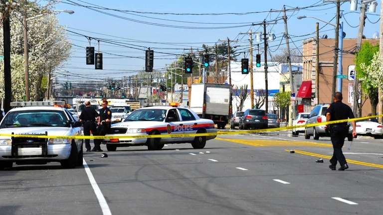 Police officers at the scene in Mineola after