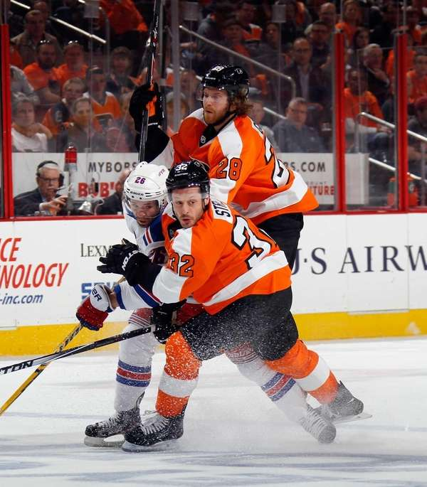 Claude Giroux and Mark Streit of the Philadelphia