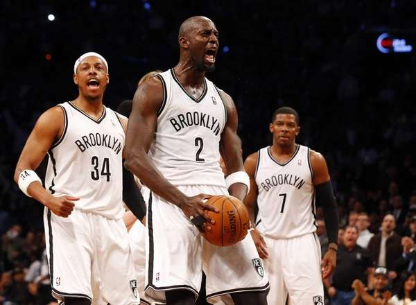 Kevin Garnett of the Nets reacts after winning