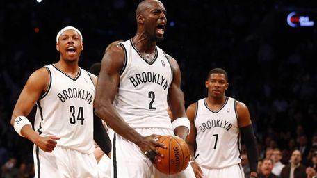 Kevin Garnett of the Nets reacts after winning