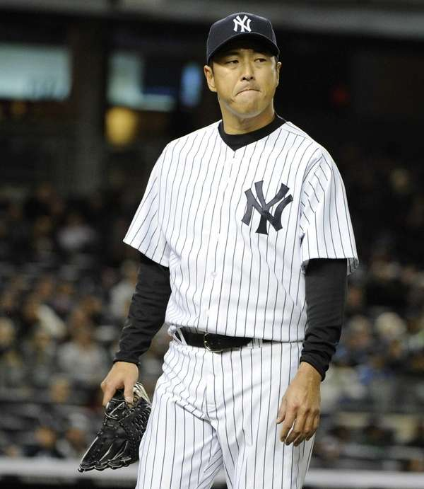 Yankees starting pitcher Hiroki Kuroda walks to the
