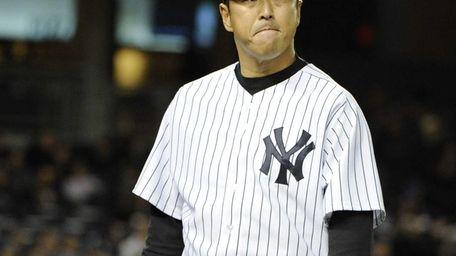 Yankees starting pitcher Hiroki Kuroda walks to the