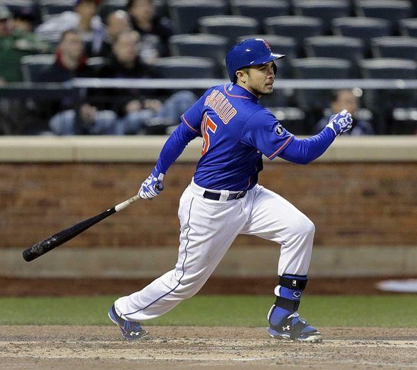 Mets catcher Travis d'Arnaud singles to right in