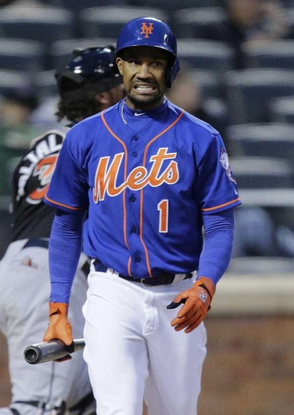 Mets leftfielder Chris Young reacts after striking out