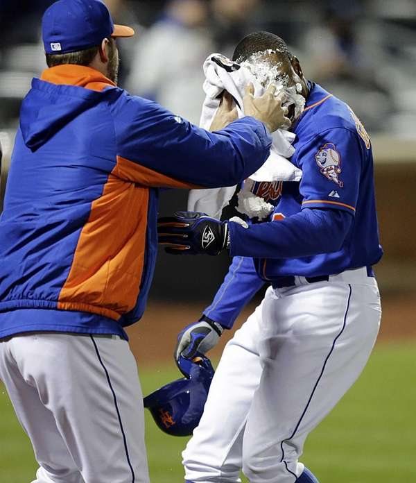 Mets rightfielder Curtis Granderson gets a pie in
