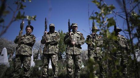 Pro Russia militia men line up during the