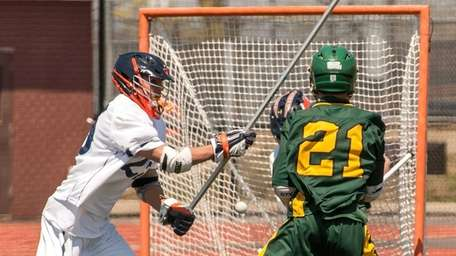 Lynbrook's Austin Fabel, right, takes a shot and