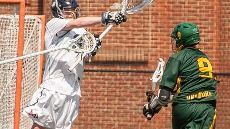 Manhasset goalie John Young, left, comes up with
