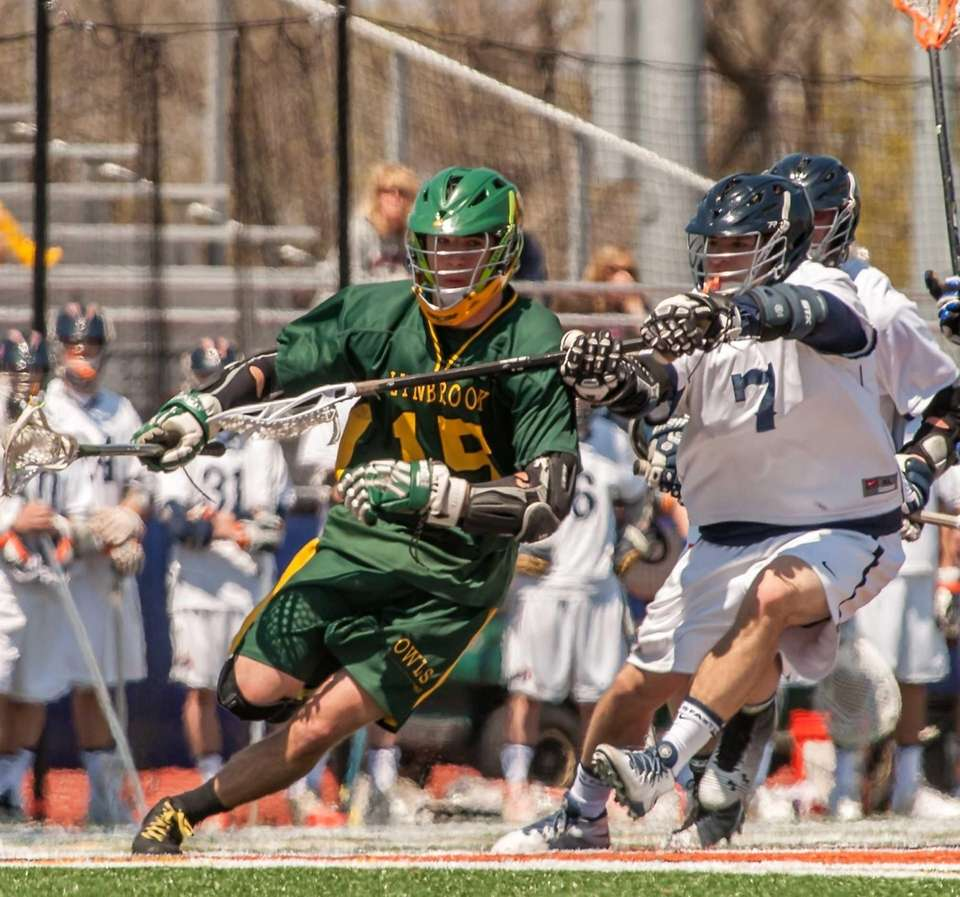 Lynbrook's Joe Grossi, left, works against Manhasset's Jack