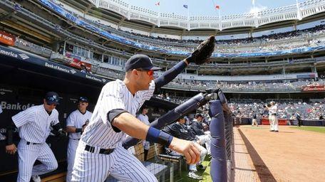 Derek Jeter of the Yankees leads his teammates