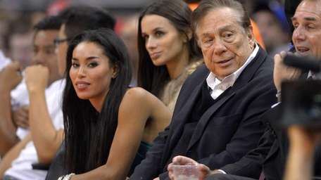 Los Angeles Clippers owner Donald Sterling, right, and