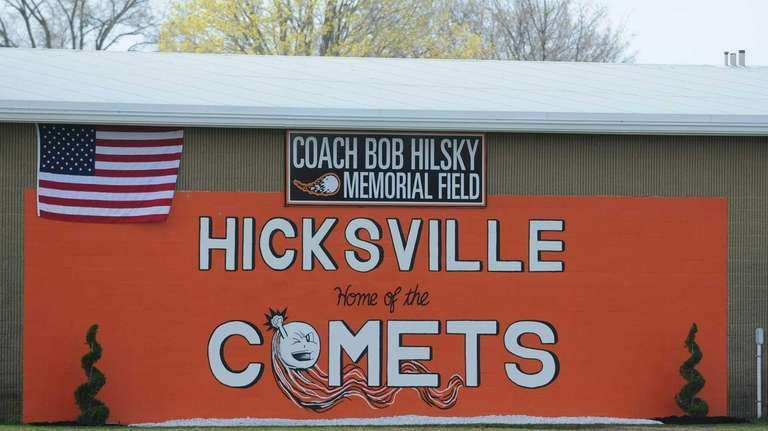 A sign honoring the memory of late Hicksville