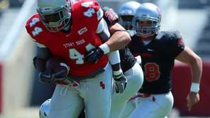 Stony Brook tight end Will Tye is dragged