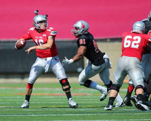 Stony Brook quarterback Conor Bednarski is pursued by
