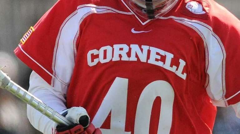 Cornell goalie Christian Knight pounces on a loose