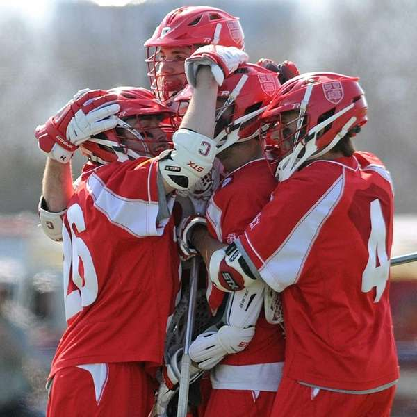 Cornell University teammates celebrate after a goal in