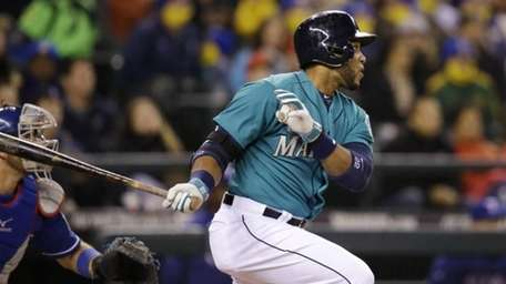 Seattle Mariners' Robinson Cano doubles in a pair