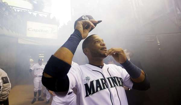 Seattle Mariners' Robinson Cano looks up as he