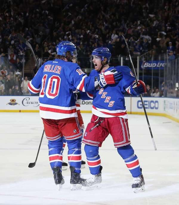 Brad Richards, right, celebrates his second-period goal along