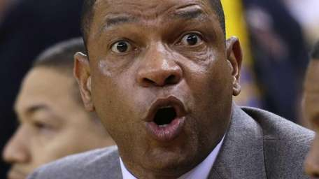 Los Angeles Clippers head coach Doc Rivers argues