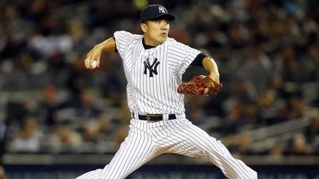 Masahiro Tanaka pitches in the first inning against