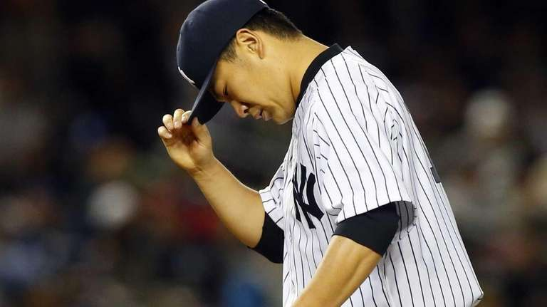 Masahiro Tanaka stands on the mound against the
