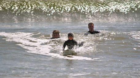 Into the waves, Aaron Sisa, 6, who is