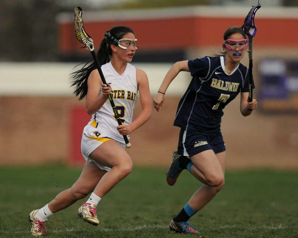 Oyster Bay's Vanessa Yu, left, looks to get