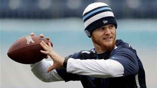 Tennessee Titans quarterback Rusty Smith warms up before