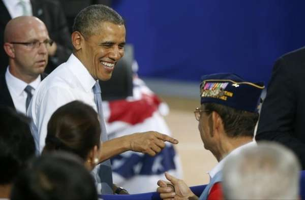 President Barack Obama greets veterans after he addressed