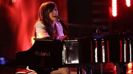 Christina Grimmie performs on Top 10 night of