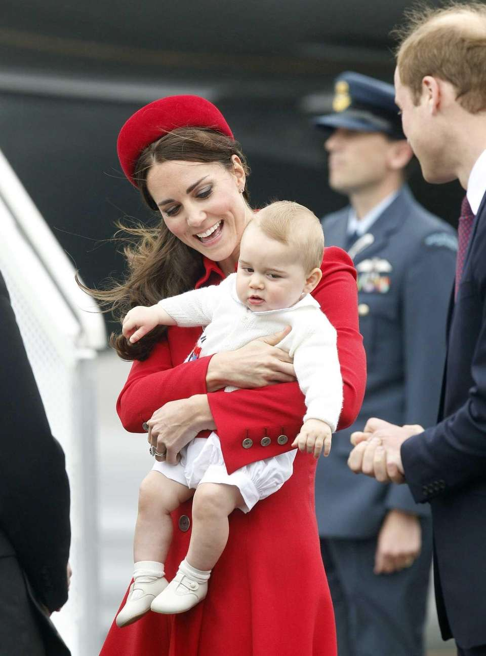 Catherine, the Duchess of Cambridge, holds Prince George