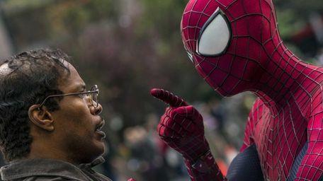 Jamie Foxx, left, and Andrew Garfield as Spider-Man