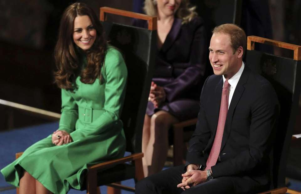 Prince William and wife Kate laugh at a