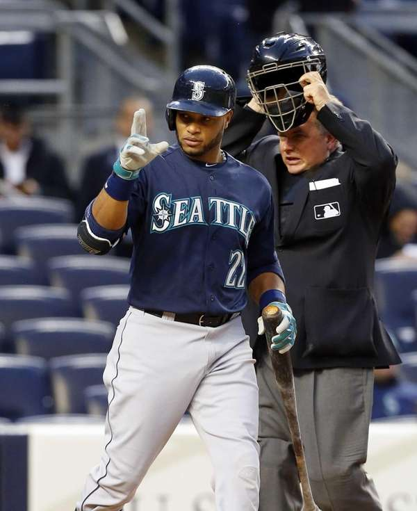 Robinson Cano of the Seattle Mariners acknowledges the