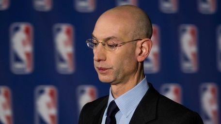 NBA Commissioner Adam Silver leaves a press conference