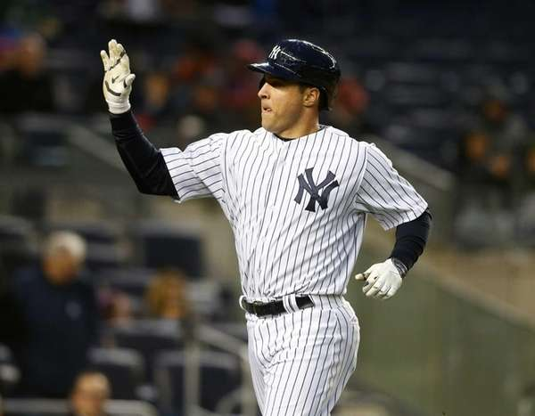 Mark Teixeira of the Yankees celebrates his second-inning